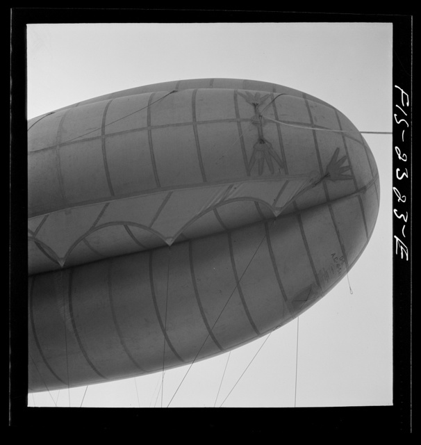 Camp Lejeune, New River, North Carolina. A view of the barrage balloon, showing the curtain and the finger patches to which they attach handling lines