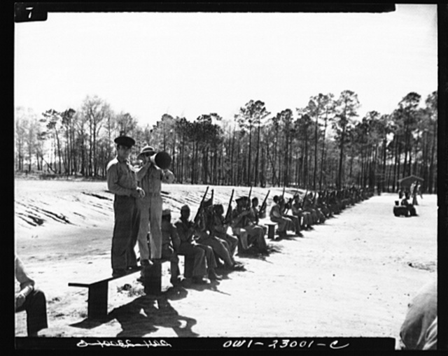 "Camp Lejeune, New River, North Carolina. Engineers of the 51st Composite Battalion, U.S. Marine Corps, practice ""on the firing line"""