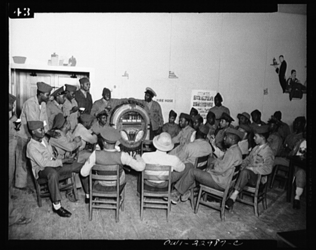Camp Lejeune, New River, North Carolina. Members of the 51st Composite Battalion, U.S. Marine Corps, relaxing with cigarettes, Coca Cola, and jukebox music