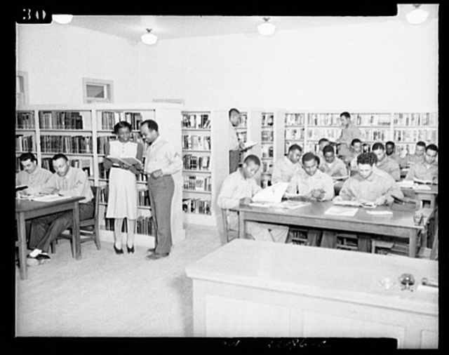 Camp Lejeune, New River, North Carolina. Scene in the library showing members of the 51st Composite Battalion, U.S. Marine Corps, studying