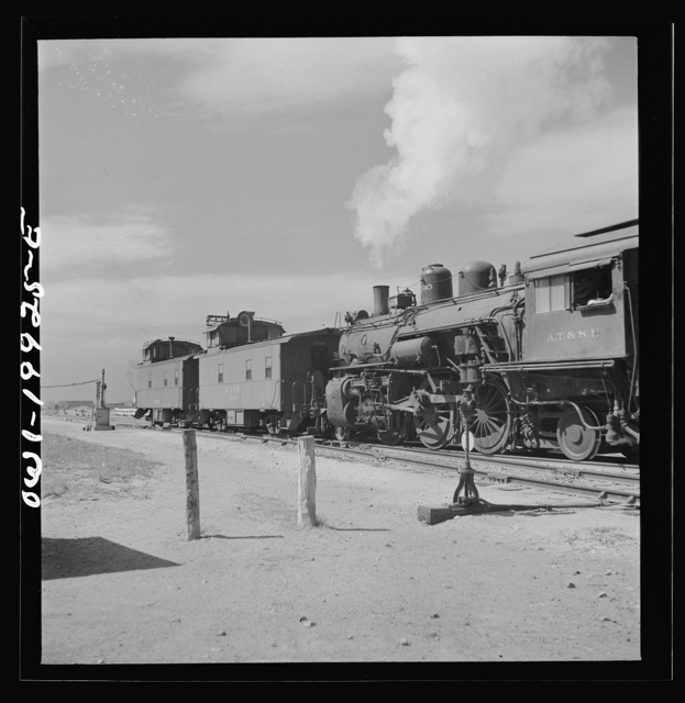 Canadian, Texas. Switch engine changing cabooses on a Atchison, Topeka and Santa Fe Railroad train