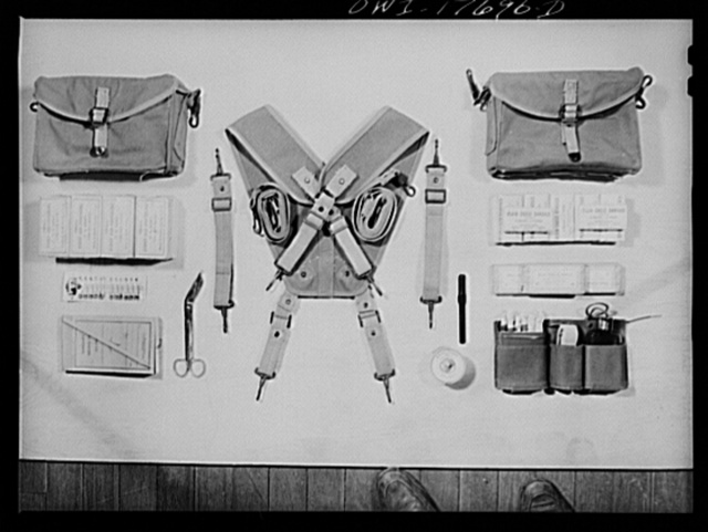 Carlisle, Pennsylvania. Medical field service training school. Contents of a medical soldier's pouches which are carried on each side by straps: different types of bandages, safety pins, emergency medical tags for identification of wounded, scissors, adhesive tape, thermometer, iodine swabs, tourniquet and aromatic spirits