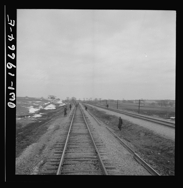 Carrollton (vicinity), Missouri. A section gang at work along the Atchison, Topeka, and Santa Fe Railroad between Marceline, Missouri and Argentine, Kansas