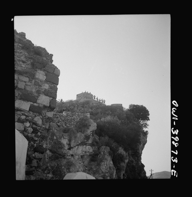 Castel Mola (vicinity). Castle on mountain peak over-looking Taormina and the sea. One of the peacetime tourist attractions visited by the British Eighth Army on a day off. Sicily