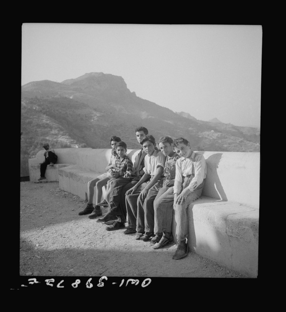 Castel Mola (vicinity), Sicily. Sicilian boys waiting to welcome soldier