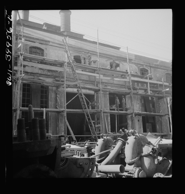 Catania, Sicily. Rebuilding the city. The Allied government is paying a wage comparable with peacetime for the labor. This money is charged to the Italian government, which will return it later