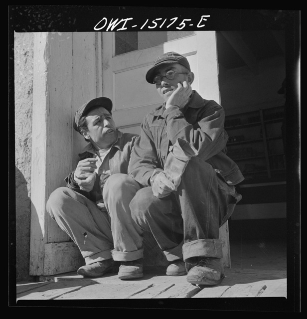 Chacon, Mora County, New Mexico. Idlers at the general store
