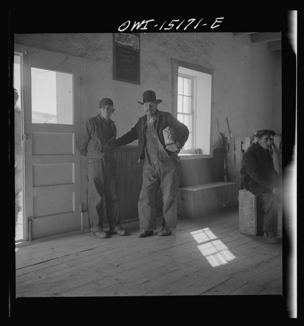 Chacon, Mora County, New Mexico. Idlers in the general store