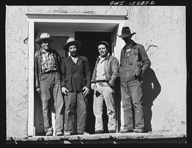Chacon, Mora County, New Mexico. Idlers on the general store steps