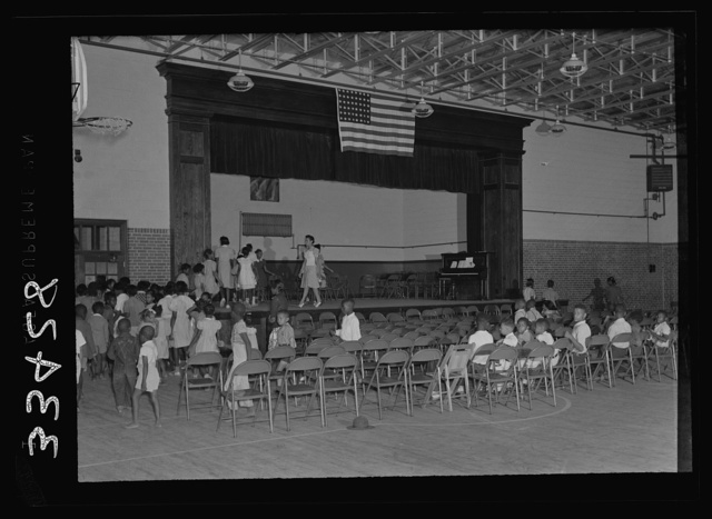 Charlotte Court House, Virginia. Central High School. A combination gym and auditorium where the seats are movable. The elementary school has no auditorium so the children have come over to pratice an operetta