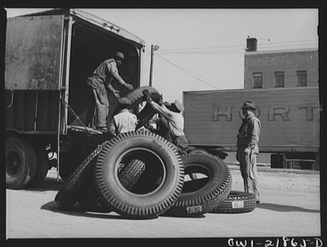 Charlotte, North Carolina. Loading tires onto a truck at the terminal of the Associated Transport Company for shipment to other terminals