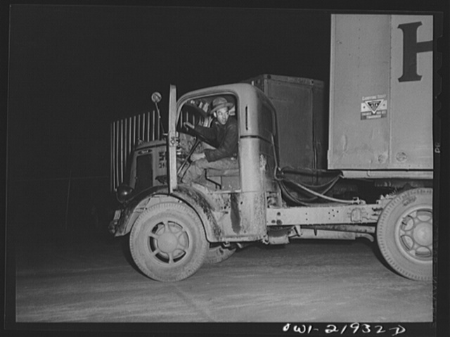 "Charlotte, North Carolina. ""Yard jockey"" backing a truck up to the unloading platform of the Associated Transport Company"