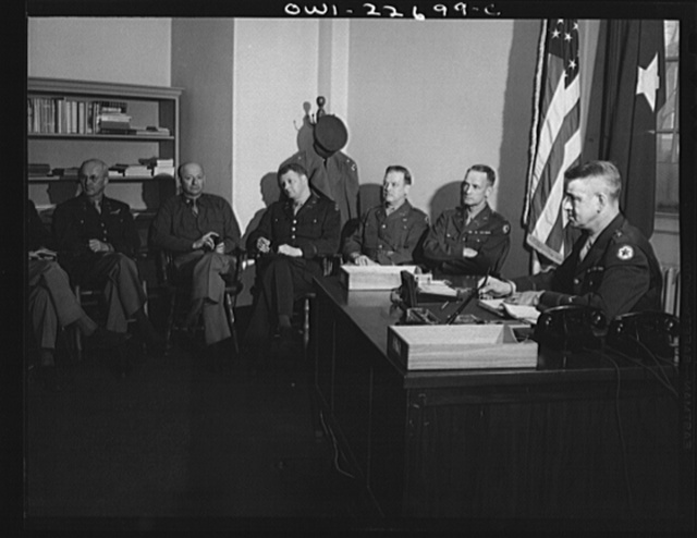 Charlottesville, Virginia. General Wickersham in conference with his staff in the School of Military Government at the University of Virginia