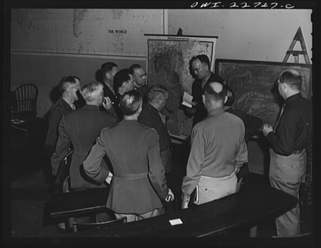 Charlottesville, Virginia. Officers enrolled in the School of Military Government gathered in informal discussion in the lecture hall of the School of Law, University of Virginia