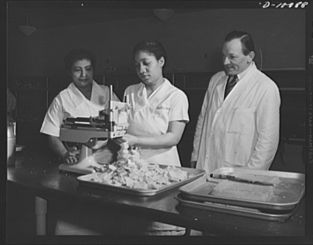 Cheese which had been dehydrated, then rehydrated, to be served at luncheon on March 11, 1943, at the Hotel Statler, Washington, D.C., in observance of the second anniversary of lend-lease, is sliced in the hotel kitchen. Some 750 guests were served