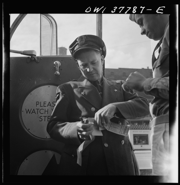 Chicago, Illinois. A bus driver collecting tickets at the Greyhound bus terminal