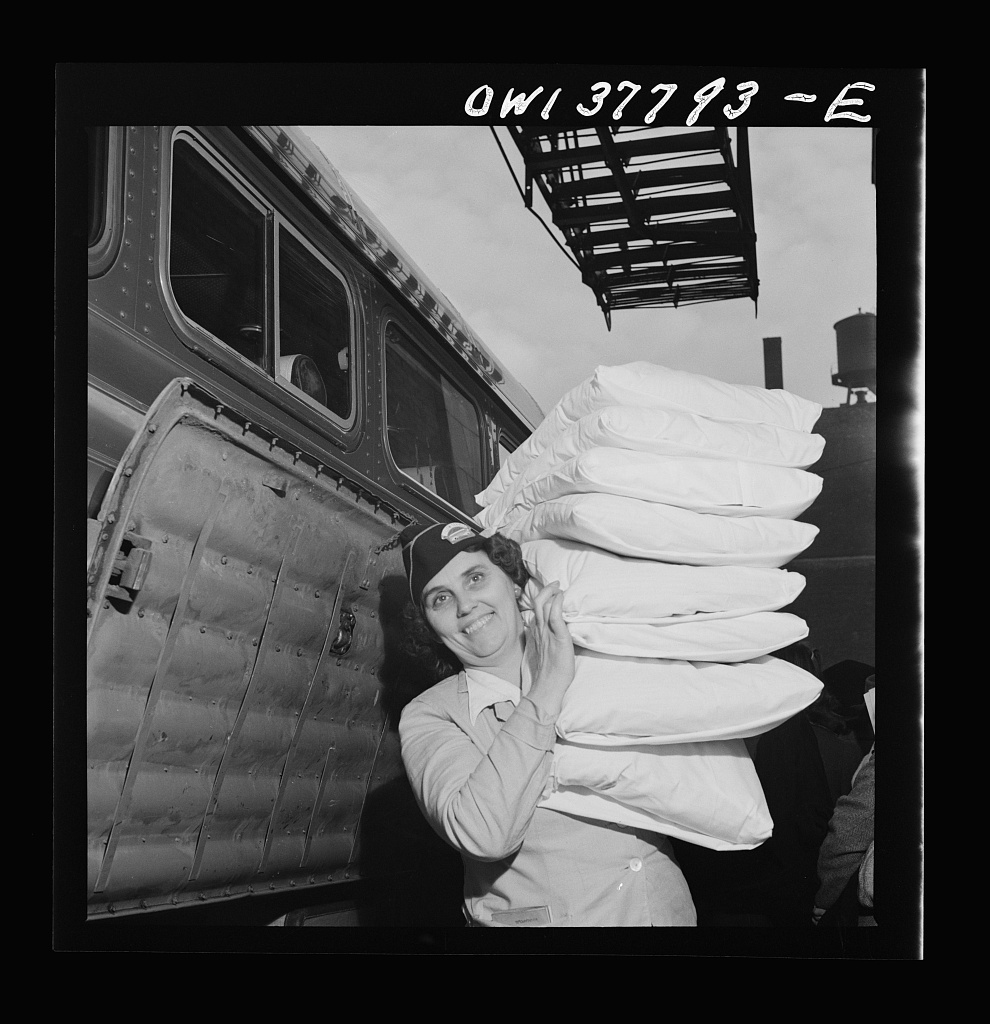 Chicago, Illinois  A pillow girl waiting to board a bus at
