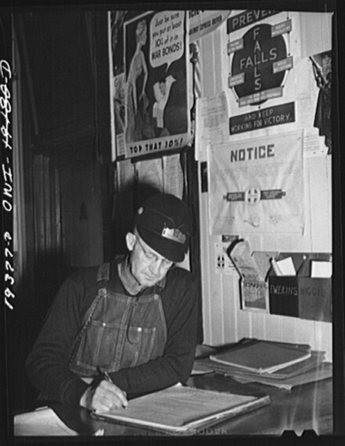 Chicago, Illinois. Atchison, Topeka and Santa Fe Railroad conductor, George E. Burton, registering before leaving with his train for Chillicothe, Illinois