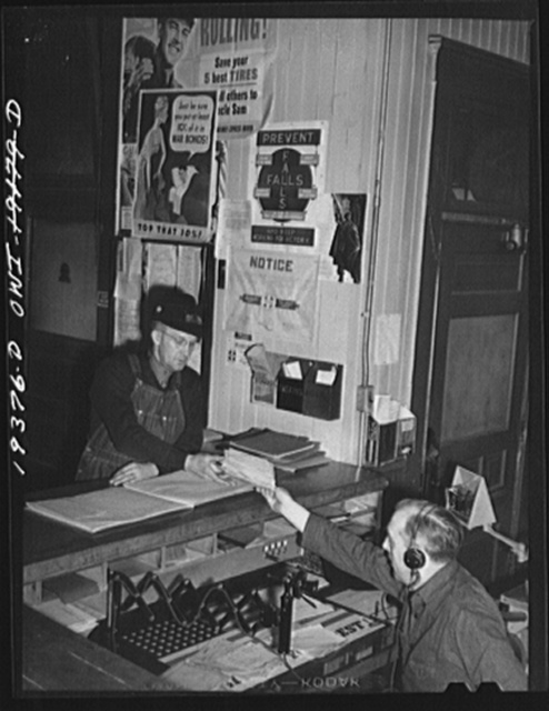 Chicago, Illinois. Atchison, Topeka and Santa Fe Railroad conductor, George E. Burton, getting his train orders at Corwith Yard before leaving for Chillicothe, Illinois