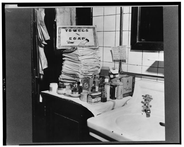 Chicago, Illinois. Bus passengers in the Greyhound bus terminal's ladies' restroom. Items ranging from soap and nail polish to soda for upset stomachs may be rented from the maid on duty, who owns her own stock. Her business is usually very brisk