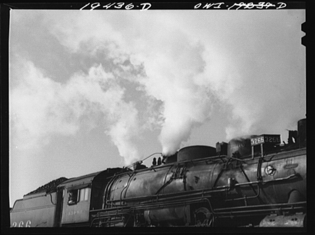 Chicago, Illinois. Engineer gives whistle blasts to indicate Atchison, Topeka and Santa Fe Railway train is ready to leave the yard