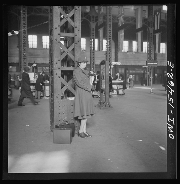 Chicago, Illinois. Member of the Women's Army Auxiliary Corps waiting for a train in Union Station