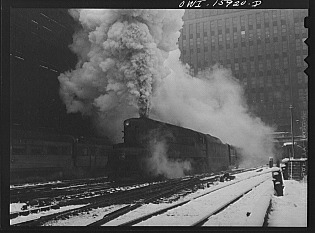 "Chicago, Illinois. One of the Pennsylvania Railroad's giant 6100 class engines pulling out of the Union Station on the ""Manhattan Limited"" run"