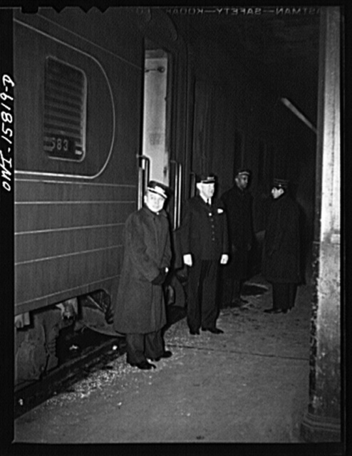 Chicago, Illinois. Porters, conductor, and brakeman at Union Station