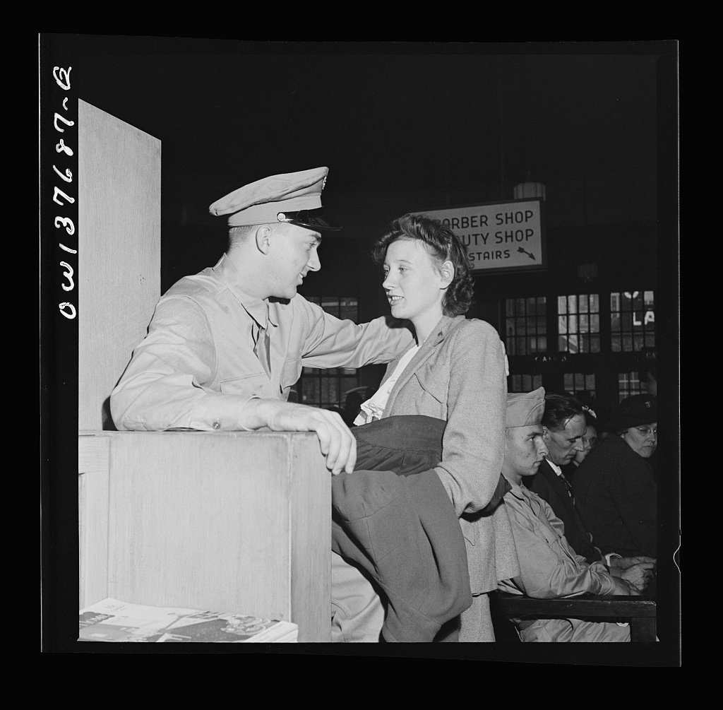 Chicago, Illinois. Private D.N. Danielson, stationed in North Carolina, and Mrs. Danielson, from Minnesota, in the waiting room of the Greyhound bus terminal. They met in Chicago to save time for his furlough