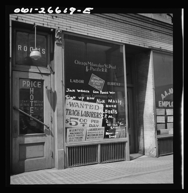 Chicago, Illinois. Railroad help wanted signs in windows of an employment agency near the Union Station