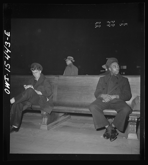 Chicago, Illinois. Sailors waiting for train in the main waiting room of the Union Station