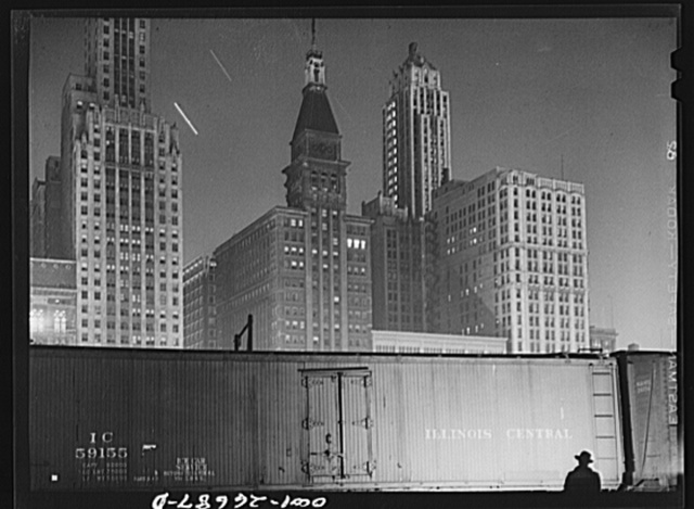 Chicago, Illinois. Special agent making his rounds at night at the South Water Street freight terminal of the Illinois Central Railroad