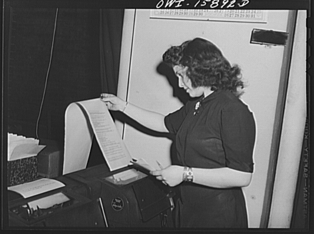 Chicago, Illinois. Teletype machines connect the reservation bureau of the Union Station with the companies' offices in various parts of the country