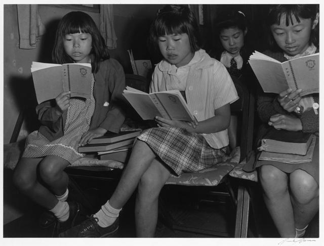 Children at Sunday school class, Manzanar Relocation Center, California / photograph by Ansel Adams.