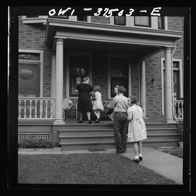 Cincinnati, Ohio. Bernard Cochran, a Greyhound bus driver, going into the house with his family. His wife and children drive down to the terminal to pick him up after work