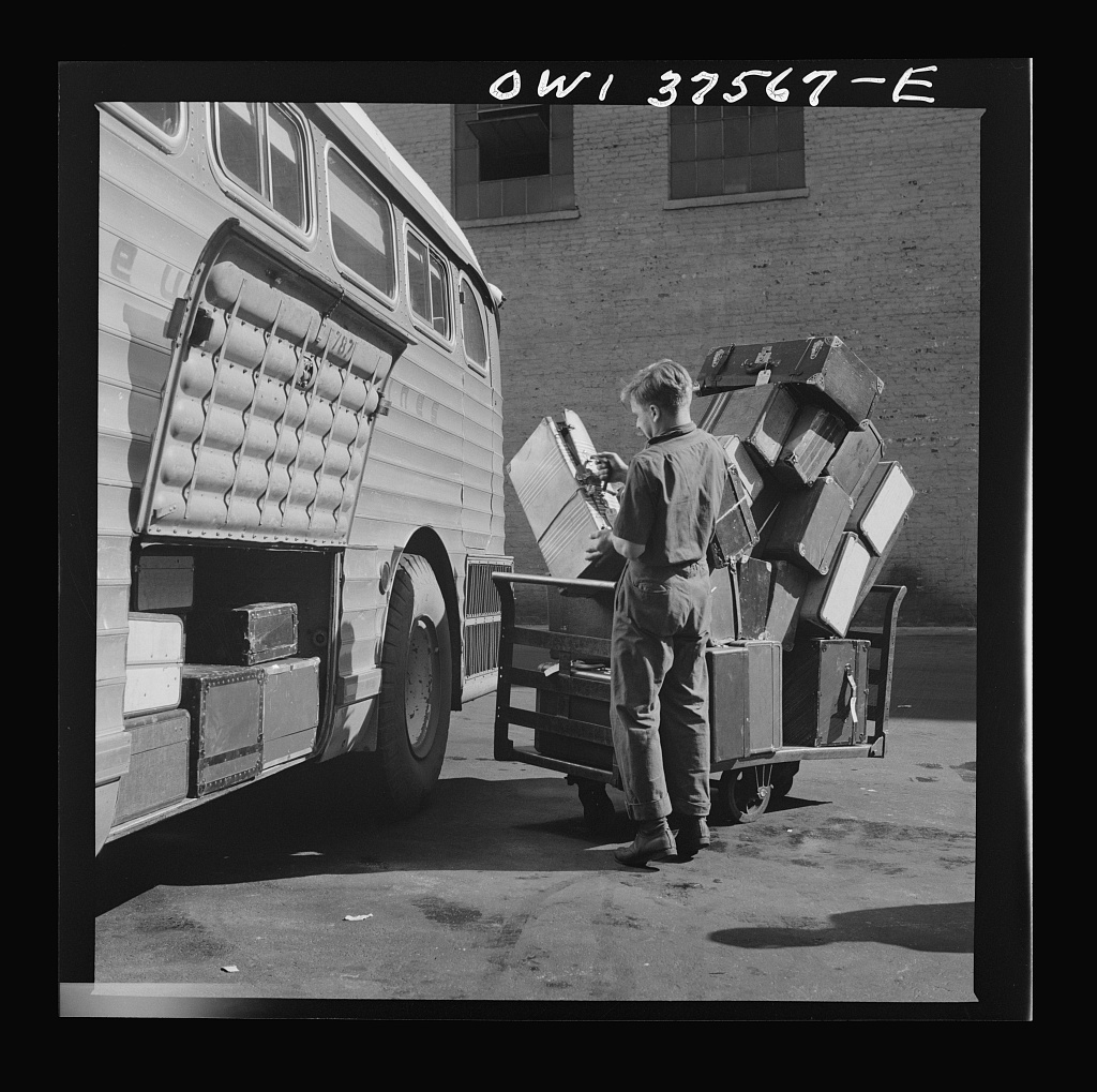 Cincinnati, Ohio. Loading baggage on a Greyhound bus at the bus terminal