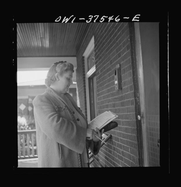Cincinnati, Ohio. Mrs. Bernard Cochran, the wife of a Greyhound bus driver, making a call to sell bonds