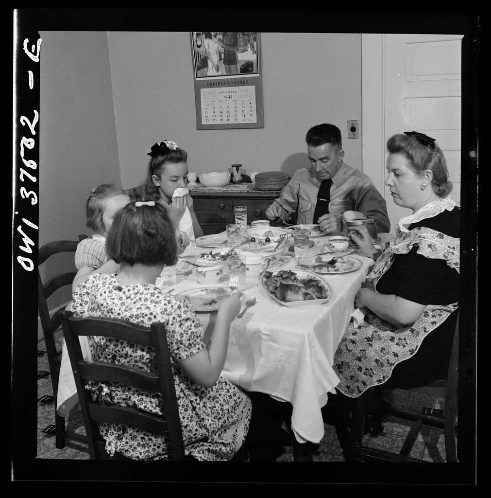 "Cincinnati, Ohio. ""Red"" Cochran, a Greyhound bus driver, and his family eating Sunday dinner"