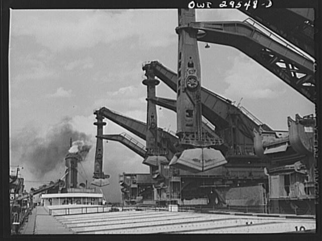 Cleveland, Ohio. Unloading a lake freighter by means of Hewlett [i.e., Hulett] unloaders at the Pennsylvania Railroad iron ore docks
