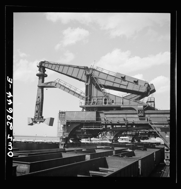 Cleveland, Ohio. Unloading iron ore from a lake freighter by means of Hewlett [i.e., Hulett] unloaders at the Pennsylvania Railroad docks
