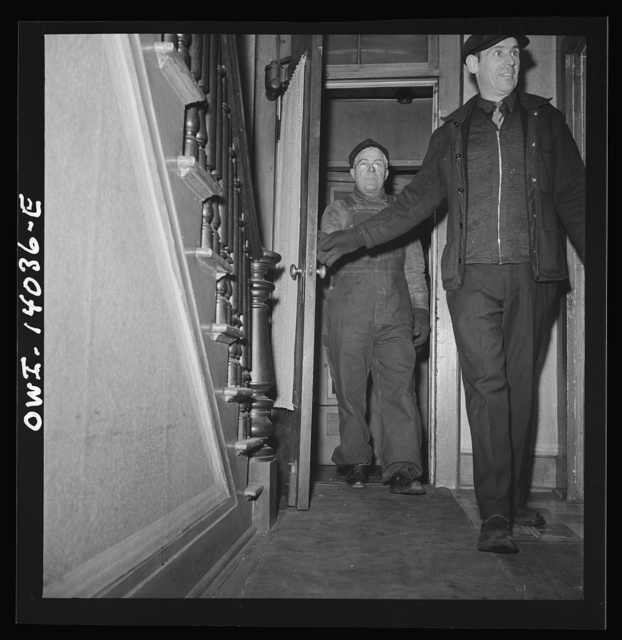 Clinton, Iowa. A train crew coming to spend the night at Mrs. Disher's, a rooming house for railroad workers