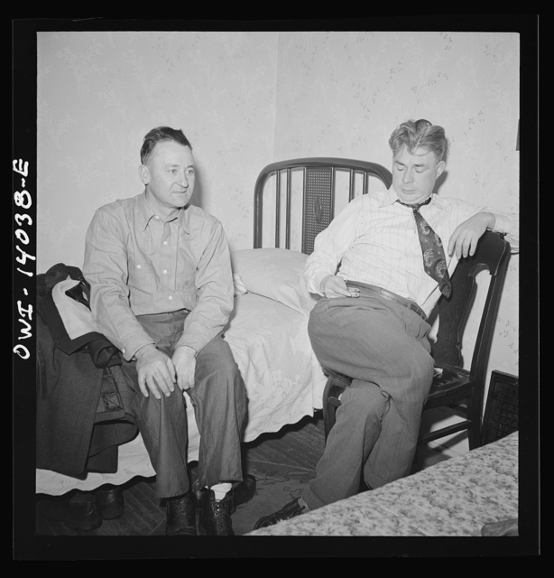 Clinton, Iowa. Jim Cross, brakeman, visiting Clarence Averill, another brakeman on the Chicago and Northwestern Railroad. He has to watch the time because he goes to work at midnight