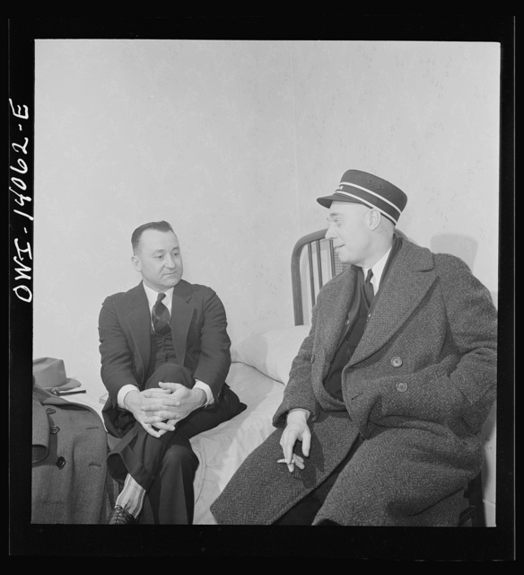 Clinton, Iowa. Lester Stein, a passenger brakeman visiting his friend Clarence Averill, a freight brakeman. Both are staying at the same rooming house