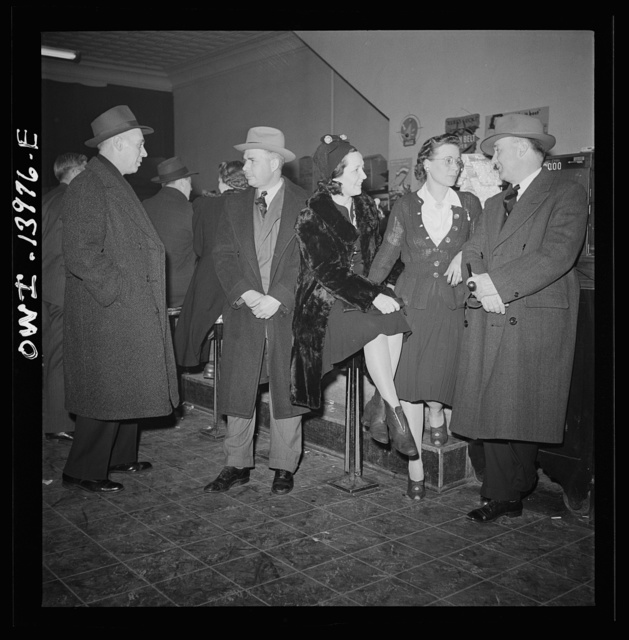 Clinton, Iowa. Rear brakeman Clarence Averill (right) goes over to the bowling alley in the evening with friends. Left to right: Lester Stein, a passenger brakeman on a streamliner; Jim Cross, a freight brakeman; and Miss Lucille Disher, who runs the boarding house where they all stay when in Clinton. The other woman is the proprietress of the bowling alley. That night was ladies night, so there was no bowling for the men. Instead, they had beer and talked