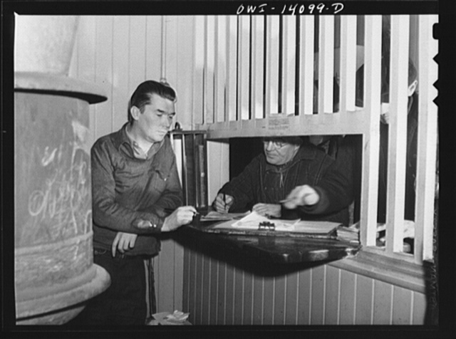 Clinton, Iowa. Train crew getting orders and clearance from the yard clerk in the Chicago and Northwestern Railroad yard office
