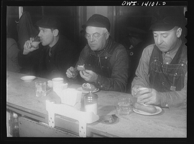 Clinton, Iowa. Train crew of a Chicago and Northwestern train having breakfast before making the trip from Clinton, Iowa to Chicago, Illinois