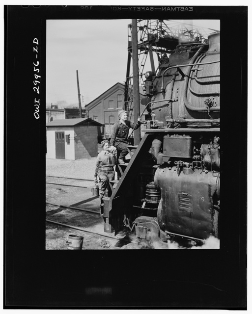Clinton, Iowa. Women wipers of the Chicago and Northwestern railroad cleaning one of the giant locomotives