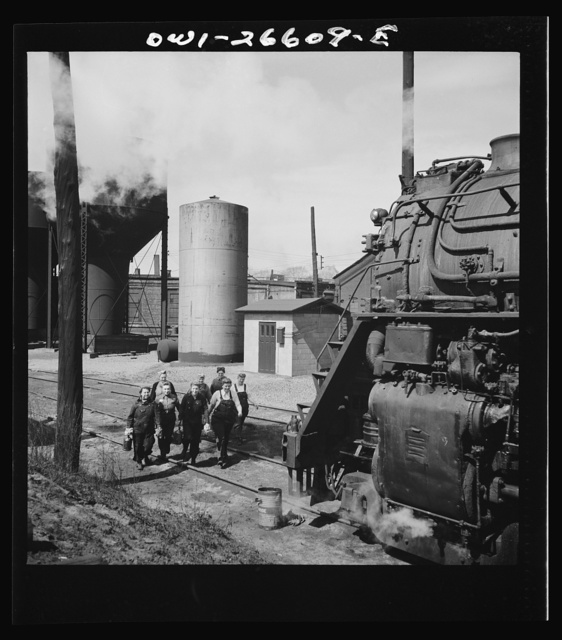 Clinton, Iowa. Women wipers of the Chicago and Northwestern Railroad going out to work on an engine at the roundhouse