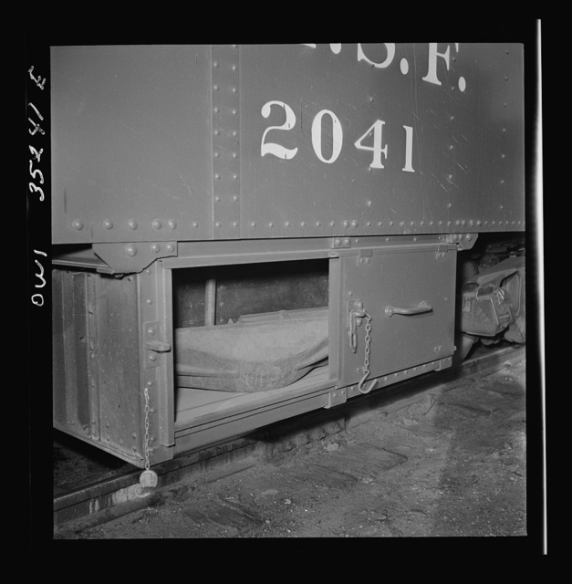 "Clovis, New Mexico. Compartment in a new Atchison, Topeka and Santa Fe Railroad caboose containing a ""frog"" for rerailing a car"