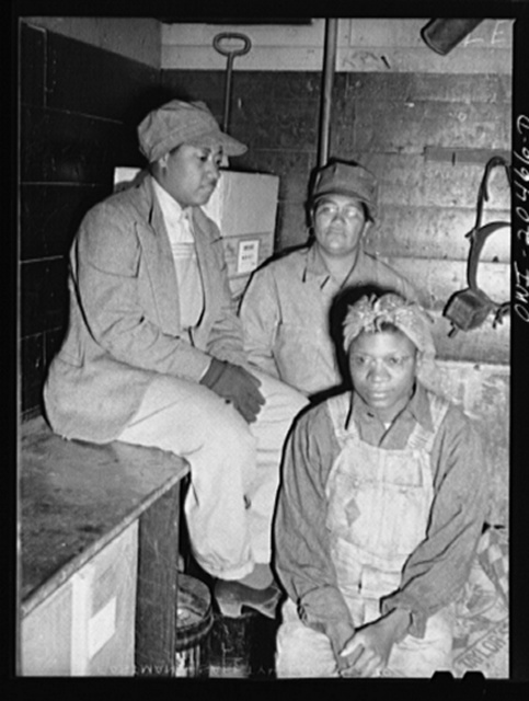 Clovis, New Mexico. Left to right: Lorraine Panol, Felecia Jones and Vera Edmore, car cleaners employed at the Clovis yard of the Atchison, Topeka and Santa Fe Railroad
